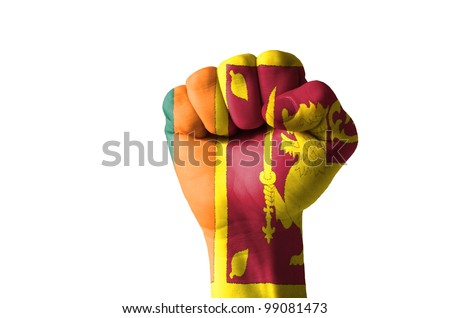 Low key picture of a fist painted in colors of srilanka flag