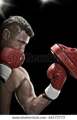 Stock Photo low key portrait of boxer getting ready for fight