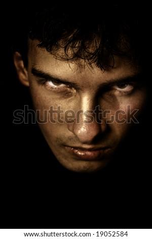 Low key portrait of evil looking man
