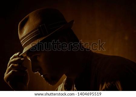 low key portrait of man with borsalino type hat Stock photo ©