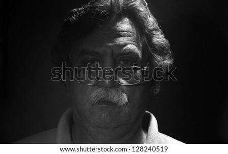 low key portrait of  middle-aged man, black and white