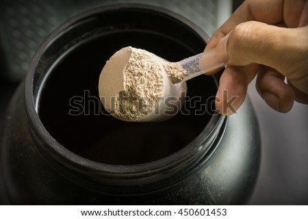 low key scoop up whey protein, selective focus