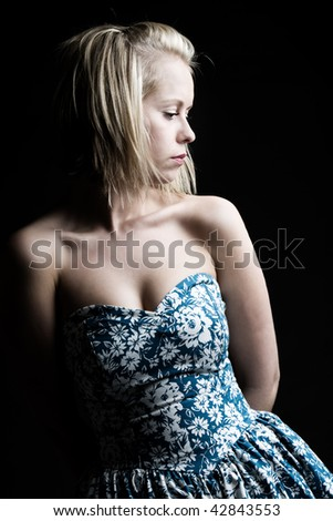 Low Key Shot of a Pretty Blonde Girl in Blue Floral Dress
