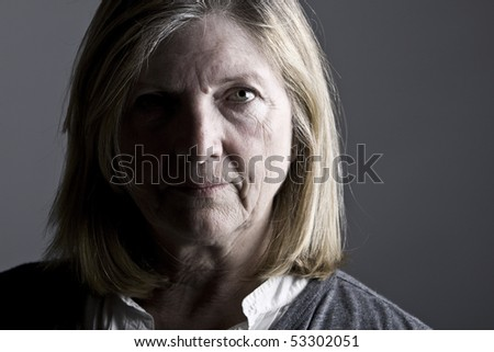 Low Key Shot of a Senior Lady against Grey Background