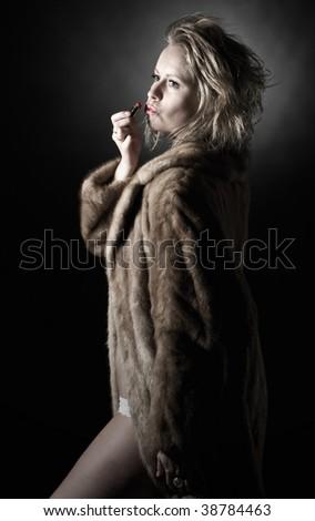 Low Key Shot of Vintage Styled Woman in Fur Coat
