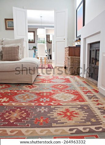 Low perspective still life of interior design home living room with a comfortable white sofa with cushions and quality carpets, interior. Aspirational and relaxing home family room, indoors lifestyle.