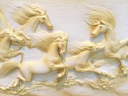 Low relief cement Thai style handcraft of horse