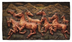 Low relief cement Thai style handcraft of horse on wall, cliping path.