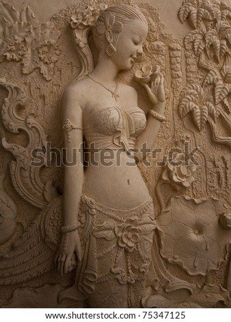 Low-relief image of beautiful woman - stock photo