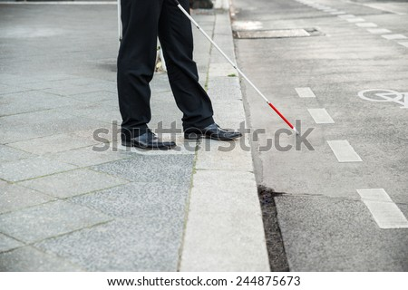 Low Section Of A Blind Person Crossing Street #244875673