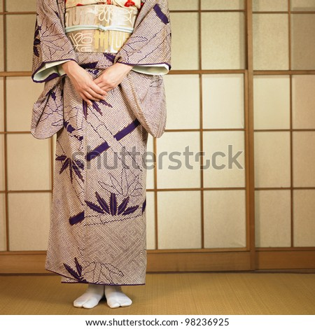 Low section of Asian woman standing