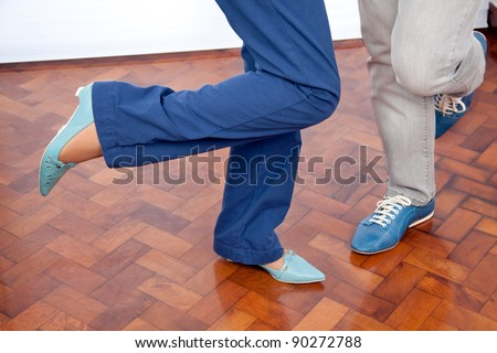 Low section of elderly couple dancing
