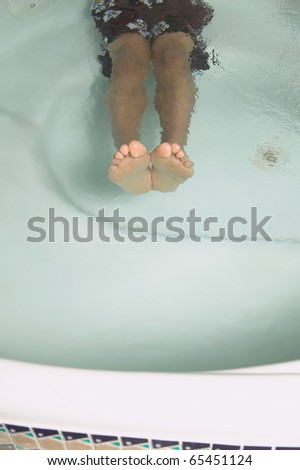 Low section of man relaxing in a jacuzzi