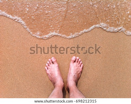 Low Section of Man Sitting At Beach #698212315