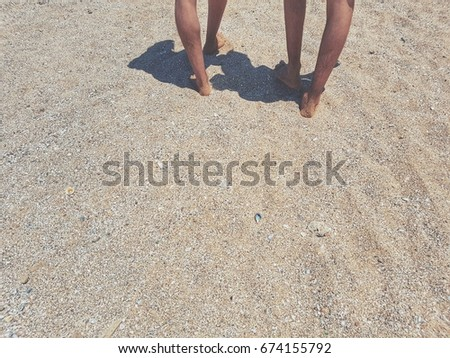 low section of tow men walking on sand in beach #674155792
