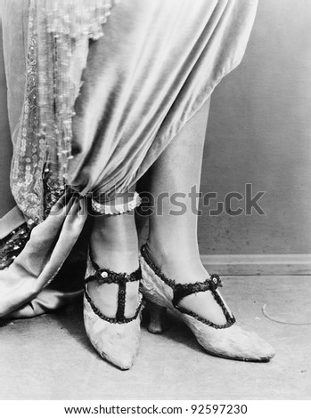 Low section view of a woman wearing shoes - stock photo