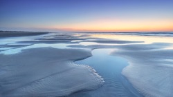 Low tide at the beach of Terschelling during sunset, the Netherlands
