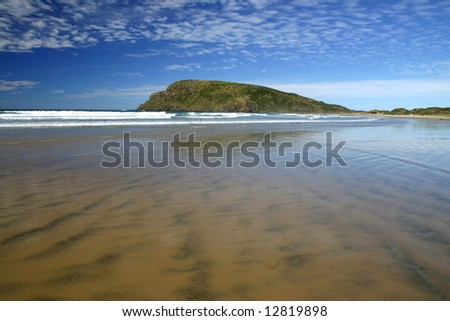 Low tide is coming in Cannibal Bay. Wide angle shot of Catlins shore. South Island. New Zealand