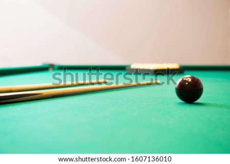 Low view of a Russian pool table with white balls pyramid,American pyramid,Dynamic pyramid,Siberian pyramid,Nevsky pyramid,Moscow pyramid games with the cue ball.