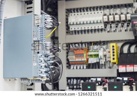 Low-voltage cabinet. Uninterrupted power.Electrical power. Technical background.Electrical switch panel of switch gear room at power plant.
