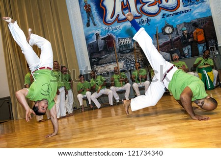 LOWELL, USA - DECEMBER 2: Capoeira masters demonstrate tricks of this Brazilian martial art style to local fans in the UTEC gymnasium in Lowell, Massachusetts, USA on December 2, 2012.