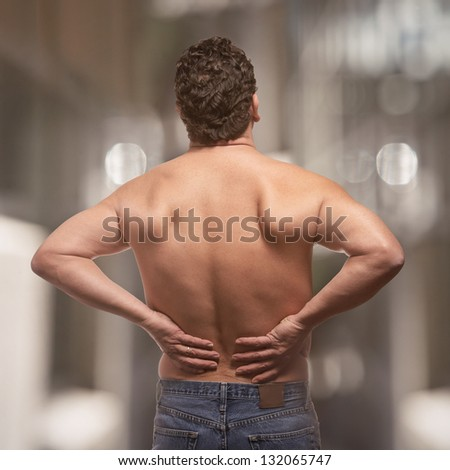Lower back pain on fit adult man