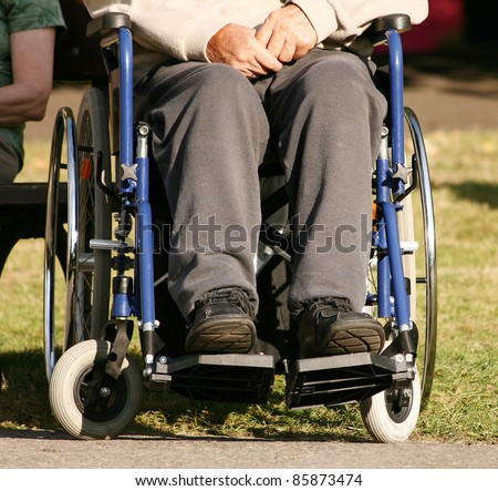 Lower body of a an elderly man sitting in a wheelchair