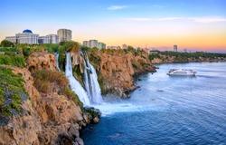 Lower Duden waterfalls on Mediterranean sea coast, Antalya, Turkey, in sunset light