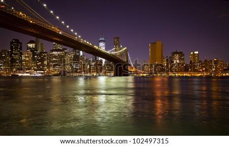 Lower Manhattan and Brooklyn Bridge in New York at nighttime