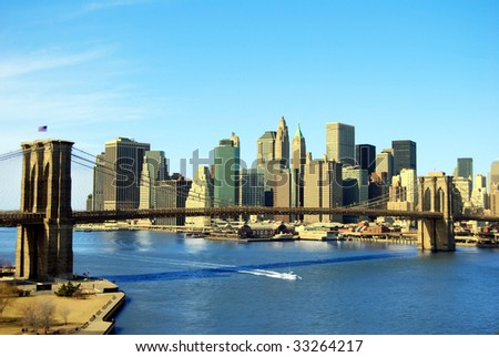 Lower Manhattan and Brooklyn Bridge in New York City - stock photo