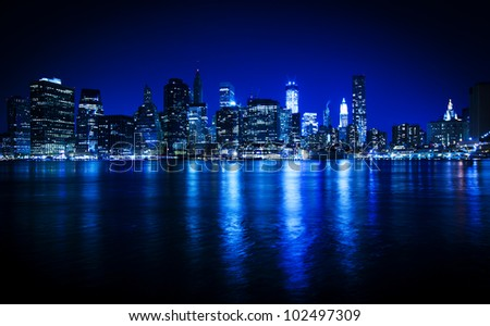 Lower Manhattan in New York in a blue hue at nighttime #102497309
