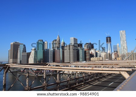 Lower Manhattan in the background of Brooklyn Bridge, in a sunny morning, New York, United States