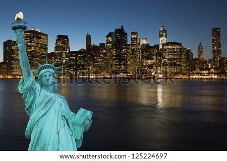 Lower Manhattan in the night. The concept of the Statue of Liberty.  (New York City, USA)