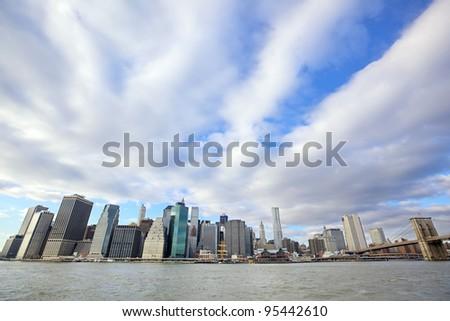 Lower Manhattan skyline and Brooklyn Bridge over East River in New York City