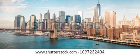 Lower Manhattan skyline from Manhattan Bridge on a beautiful day. #1097232404