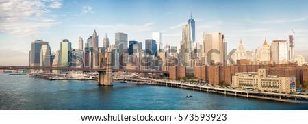 Lower Manhattan skyline from Manhattan Bridge on a beautiful day. #573593923