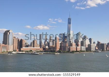 Lower Manhattan Skyline with One World Trade Center - stock photo