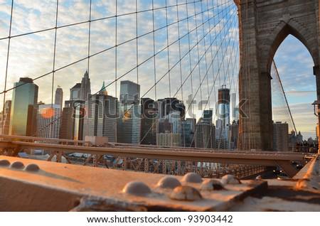 Lower Manhattan through Brooklyn Bridge at sunset,  New York City - United States
