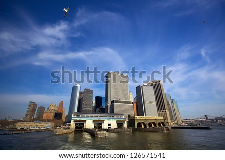Lower Manhattan urban skyscrapers and Whitehall South Ferry Terminal, New York