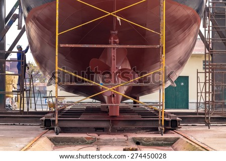 Lower part of stern and propeller detail of a fishing boat in a shipyard for maintenance