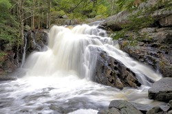 Lower Purgatory Falls. Breathtaking view of narrow rocky gorge and scenic waterfall along Purgatory Brook in southern New Hampshire.