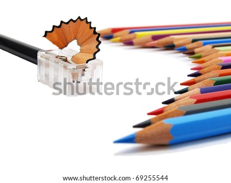 lower view of colored pencils and sharpener on white background