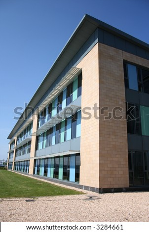 lowrise modern office building with grass