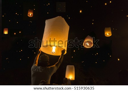 Loy Krathong Festival Balloon fire or yeepeng. Floating lantern on the Sky, flying lanterns, hot-air balloons in Chiang Mai,Thailand