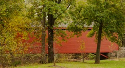 Loy;s Station Covered Bridge is in Frederick Count y Maryland near Thurmont. The fall colors are just on the verge of changing in mid October.