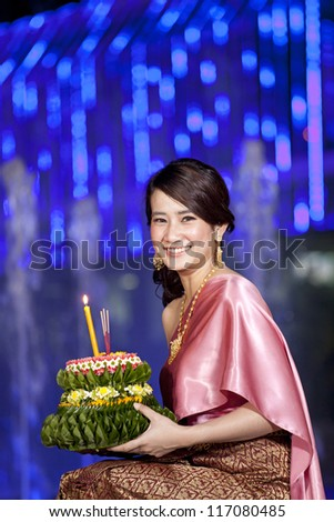 Loykratong festival, Thai woman hold kratong in front of fountain light