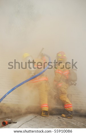 Lt Martin and FF Sullivan working an active attic fire in a Single family dwelling on fire on SE Mill Street in the Mill Pine Historic District of Roseburg Oregon.
