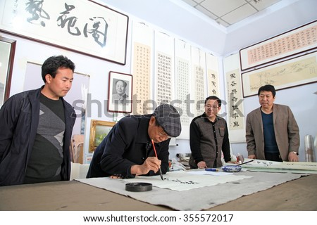 Luannan - April 7: writing calligraphy on April 7, 2015, luannan county, hebei province, China