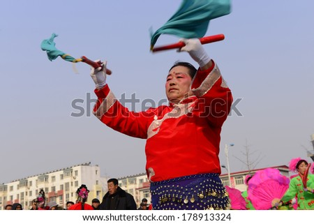 LUANNAN COUNTRY, CHINA - February 12, 2014: people wearing colorful clothes to yangko dance performances in square, hebei province