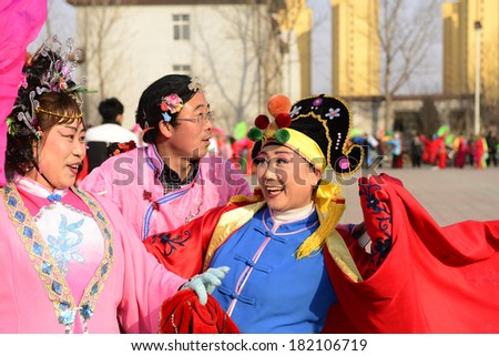 LUANNAN county - Feb. 18: people wearing colorful clothes to yangko dance performances in square, on February 18, 2013, LUANNAN county, hebei province, China.